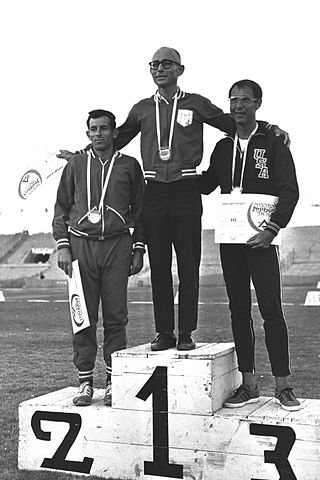 The winners of the 10,000 m walk on the podium, during the 8th Maccabia Games held at the Ramat Gan Stadium.