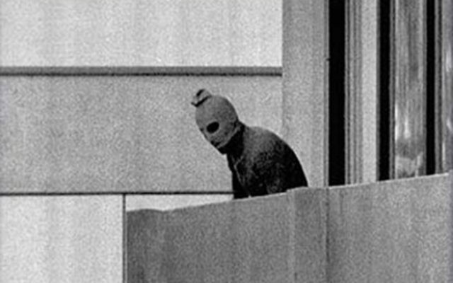 A  masked terrorist on top of the balcony during the Munich massacre of 1972