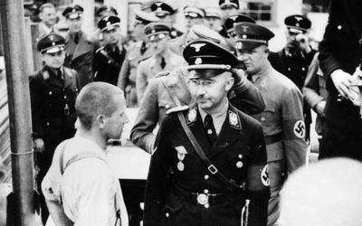 Himmler (front right) beside a prisoner whilst visiting the Dachau Concentration Camp in 1936