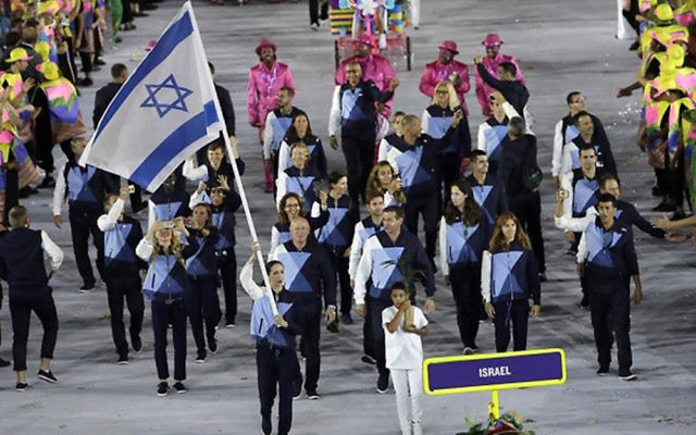 Neta Rivkin leads the Israeli delegation out at the opening ceremony, prior to which, Lebanese officials refused to allow Israeli athletes to board a bus with them to take them to the stadium