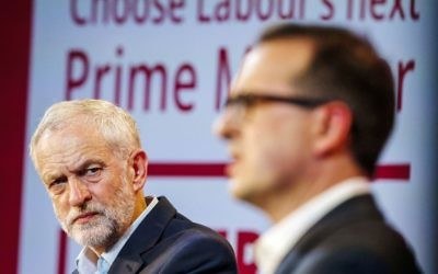 Jeremy Corbyn (left) looks on at his rival Owen Smith (right) during a leadership debate