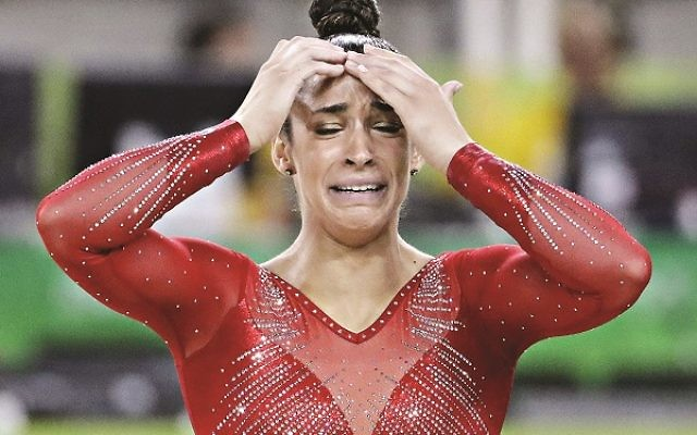 United States' Aly Raisman reacts to news of her silver medal for the artistic gymnastics women's individual all-around final at the 2016 Summer Olympics in Rio de Janeiro, Brazil, Thursday, Aug. 11, 2016. (AP Photo/David Goldman)