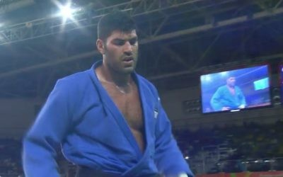 Sasson trudges off the mat having lost his semi-final in dramatic style