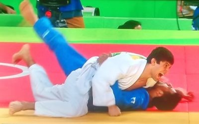 Sagi Muki (blue) on the end of an Ippon which ended his medal hopes