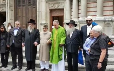 Members of different faiths together at a vigil in 2016