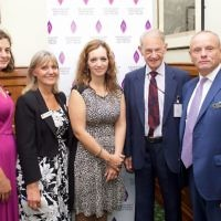 Survivor John Hajdu (centre) next to MP Mike Freer, standing alongside Laura Marks (far left) and other guests