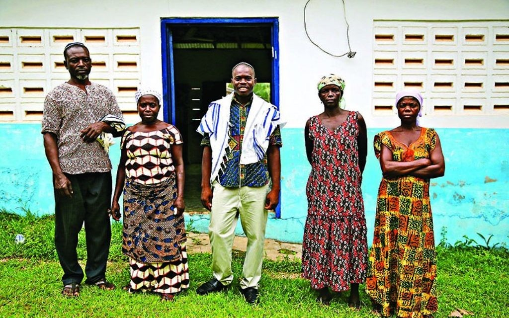 Spiritual leader Alex Armah, centre, with community members at shacharit (morning) service at Tifereth Israel Synagogue, House of Israel Jewish Community in New Adiembra, Ghana.  Photographed in February 2014