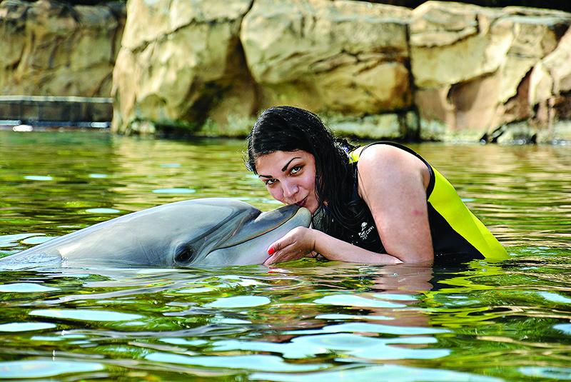 Sarah with Roxy the dolphin