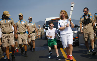 Rio and mum Juliette with the Paralympic Flame