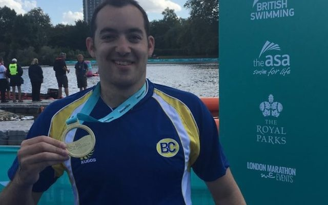 Adam Warner with his gold medal