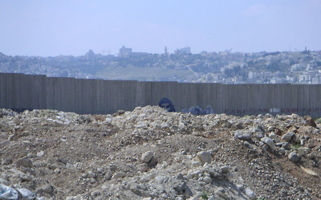 A wall snaking through the West Bank, which separates Jewish and Palestinian areas