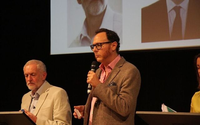 Jeremy Corbyn appearing at JW3 whilst Raymond Simonson introduces the debate   Picture credit: Joel Seshold