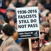 Demonstrators march for Cable Street in the East End of London. (Photo credit: Jonathan Brady/PA Wire)