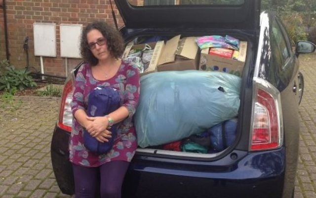 Holly Kal-Weiss with a car-full of undelivered aid