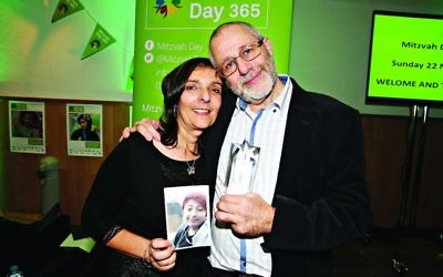 Last year's posthumous winner's parents John and Judith Morgan receive the award on behalf of their daughter Rachel