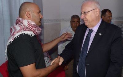 President Reuven Rivlin of Israel meeting with the father of slain teenager Nimer Abu Amar,   (Mark Neiman/Israeli Government Press Office)