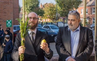 Rabbi Baruch Levine with Yousif Al-Khoei, waving the lulav and etrog