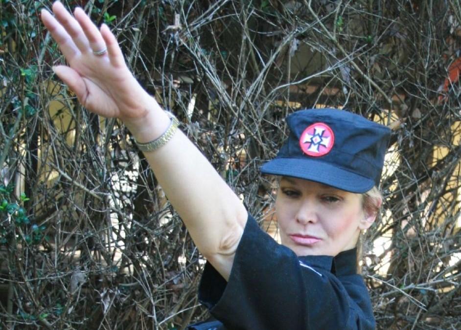 A female KKK member doing a Hitler salute (Image provided by Hope Not Hate)