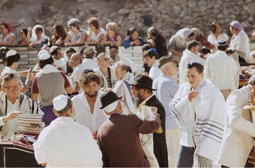 Bob Dylan, third from left, with his son Jesse, in the white tallis on right, at the Western Wall in September 1983. (Facebook)