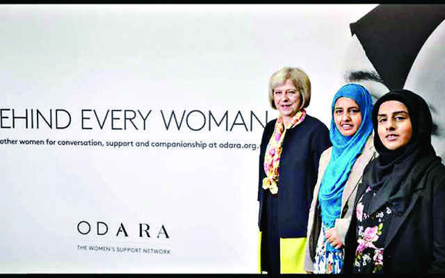Prime Minister Theresa May with Odara founder Aysha Iqbal (right)