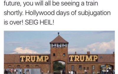 A screenshot of a tweet, featuring Auschwitz with 'Trump' on the infamous entrance