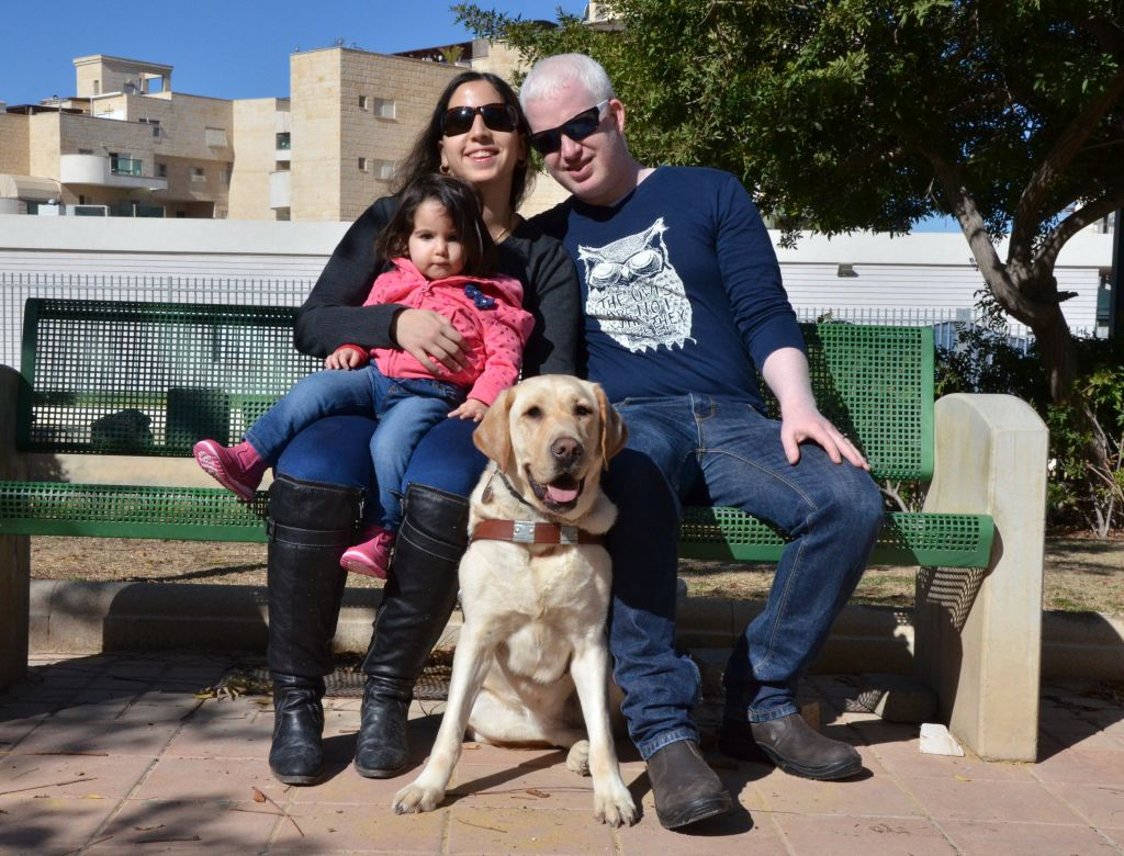 Orit Ray with her family and guide dog Julie