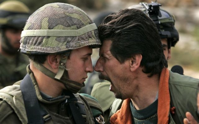 A Palestinian man argues with an Israeli soldier during a demonstration near the West Bank city of Ramallah.