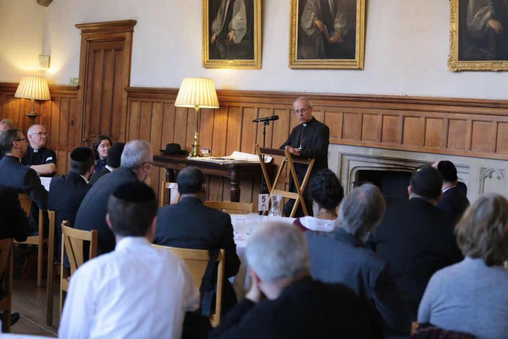 Justin Welby addressing an audience at Lambeth Palace