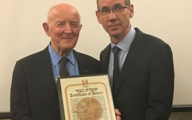 Ambassador Mark Regev presenting Andrzej Pluskowski with the official title of Righteous Amongst the Nations, on behalf of his parents, at the Embassy of Israel