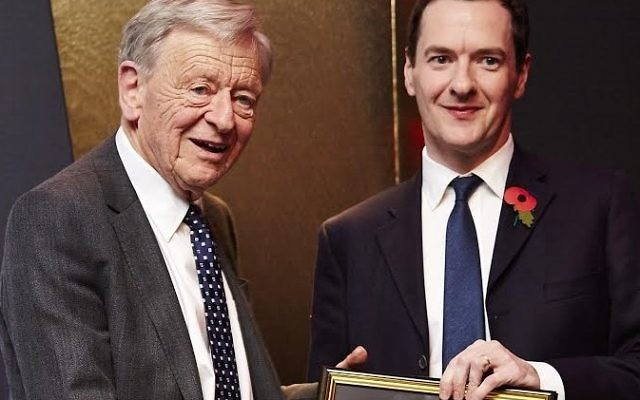 Lord Dubs being presented Peer of the Year Award by former Chancellor George Osborne
