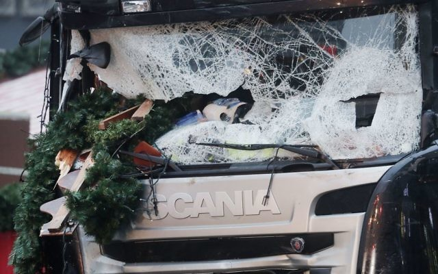 The smashed window of the cabin of a truck which ran into a crowded Christmas market on Monday evening killing several people (AP Photo/Markus Schreiber)