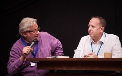 Momentum chief Jon Lansman (left), in a heated discussion next to the chair of the Jewish Labour Movement Jeremy Newmark  (Photo Credit: Eli Gaventa)