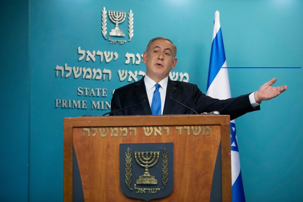 Israel's ruling coalition survives as hawkish rival gets back in line