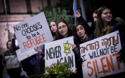 Protesters holding placards during near the Prime minister residence in Jerusalem against Trump's recent anti-refugee and anti-migrant Executive Orders (Photo by: JINIPIX)