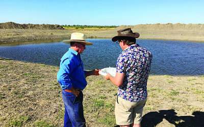 Andrew Hamilton on the right with a farmer in Australia