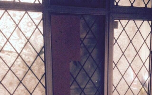 The smashed window, posted online by Shomrim North West London
