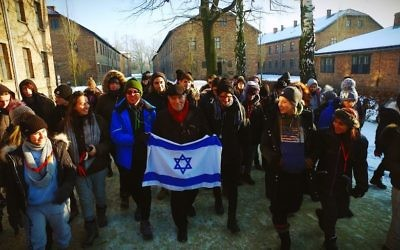 Leslie leads 100 students from Manchester King David and Yavneh schools out of Auschwitz