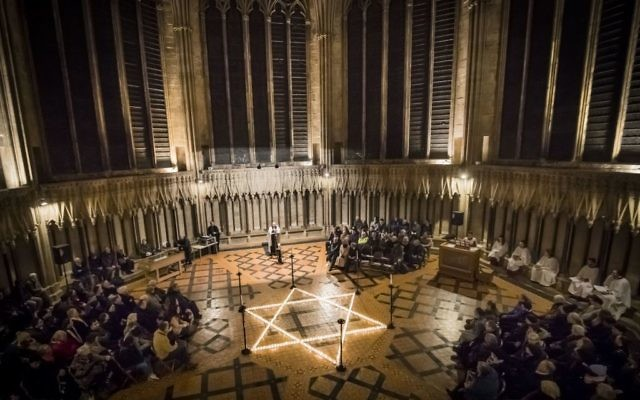 600 candles in the shape of the Star of David are seen during a commemoration for Holocaust Memorial Day at York Minster, York, 2017.