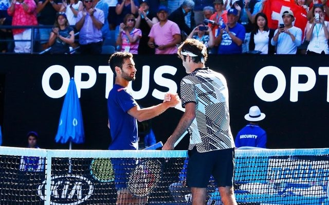 Noah Rubin congratulates Roger Federer after their second round clash on Wednesday morning. Picture: Peter Haskin/AJN