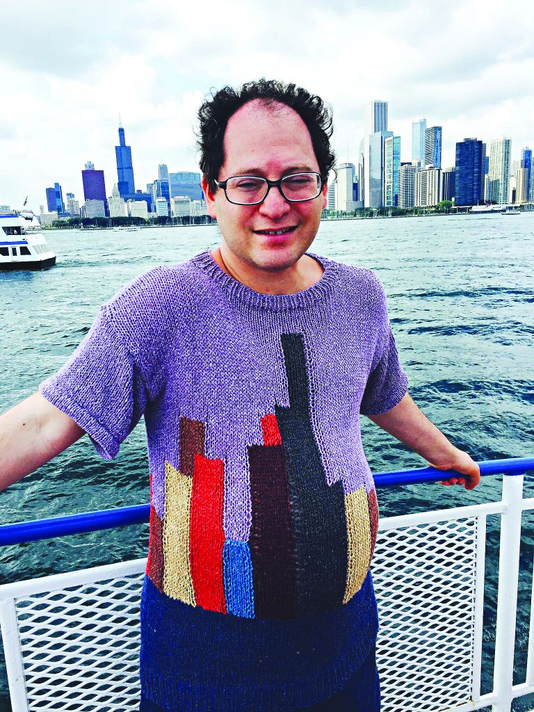 A jumper with the New York City skyline on it, with Manhattan in the background