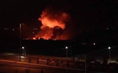 Mezzeh military airport in flames on Friday.