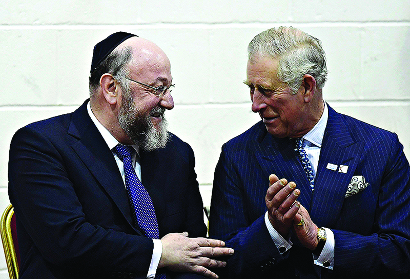 The Prince of Wales (right) speaks with chief rabbi Ephraim Mirvis during a visit to Yavneh College, an Orthodox Jewish school in Borehamwood, Hertfordshire.