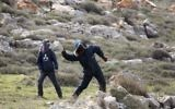 Settlers throw stones at police in Amona outpost in the West Bank (AP Photo/Ariel Schalit)