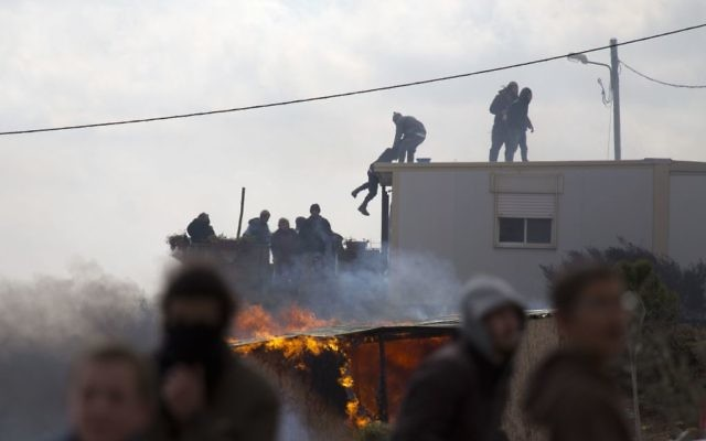 Settlers climb on top of a trailer in Amona outpost in the West Bank  (AP Photo/Ariel Schalit)
