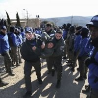 Israeli police evicts settlers from the West Bank outpost of Amona,  (AP Photo/Oded Balilty)