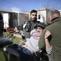Israeli police detain settlers in the West Bank outpost of Amona,  earlier in February  (AP Photo/Oded Balilty)
