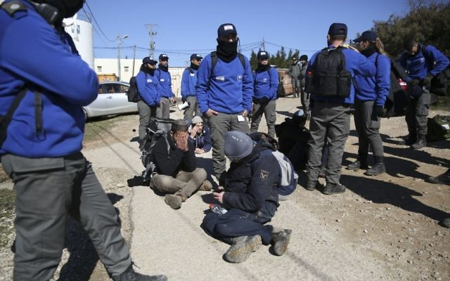 Israeli police detain settlers in the West Bank outpost of Amona, Thursday, Feb. 2, 2017.   (AP Photo/Oded Balilty)