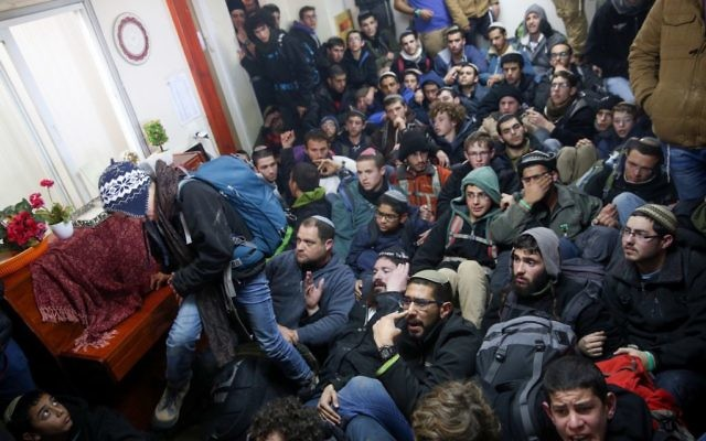 Israeli police evict settlers from the West Bank outpost of Amona, Wednesday. (Photo by: JINIPIX)