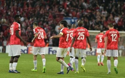 Hapoel Be'er Sheva celebrate their equaliser on Thursday night, though know they have to score at least three times in Thursday's second leg to reach the last 16.