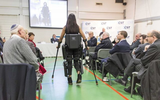 Nicki Donnelly demonstrating the suit to the audience, which featured members of the Jewish community and current and former police officers (Photo credit: Jason Glass)